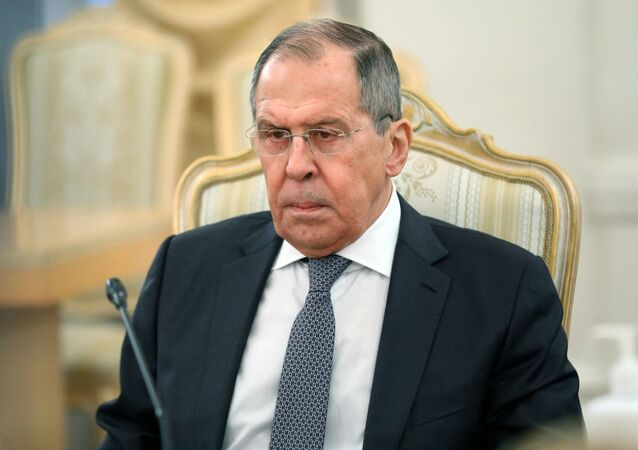 Russian Foreign Minister Sergei Lavrov during a meeting with his Afghan counterpart Mohammad Hanif Atmar on Friday, February 26, 2021.