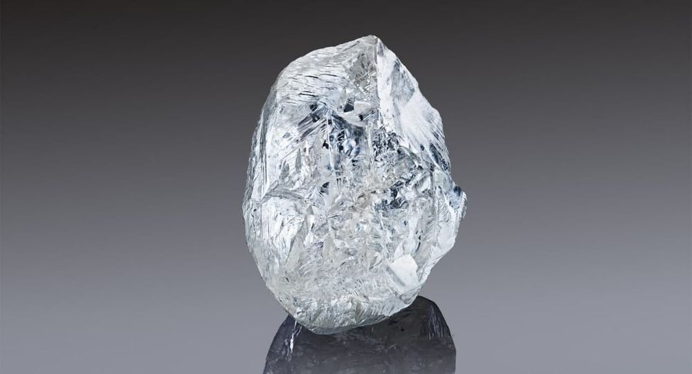 In this handout photo released by the Russian diamond producer Alrosa, a view shows a rare 242-carat rough diamond, which will be offered at the 100th international auction of Alrosa in Dubai on March 22, 2021