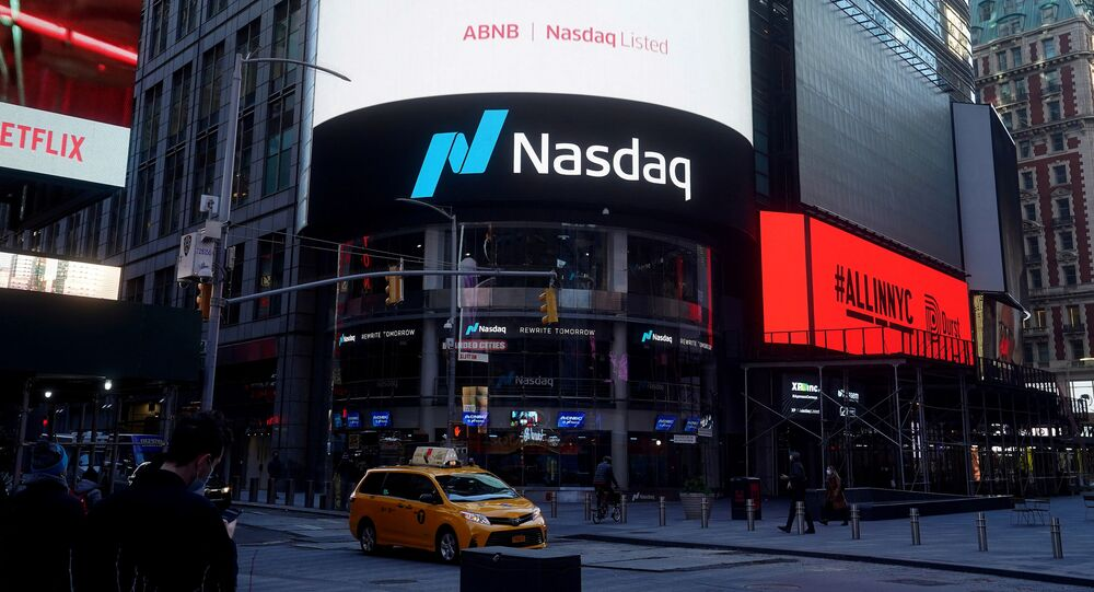 The NASDAQ market site displays an AirBnb sign on their billboard on the day of their IPO in Times Square in the Manhattan borough of New York City, New York, U.S., December 10, 2020
