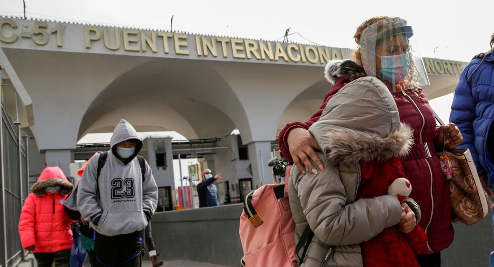 Migrants from Central America, under the Migrant Protection Protocols (MPP) program, walk across the Paso del Norte international border bridge from the Mexican side to continue their asylum request in the United States, in Ciudad Juarez, Mexico February 26, 2021.