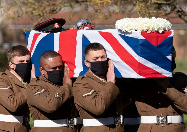 The coffin of Captain Sir Tom Moore is carried by members of the Armed Forces during his funeral at Bedford Crematorium, amid the coronavirus disease (COVID-19) outbreak, in Bedford, Britain February 27, 2021.