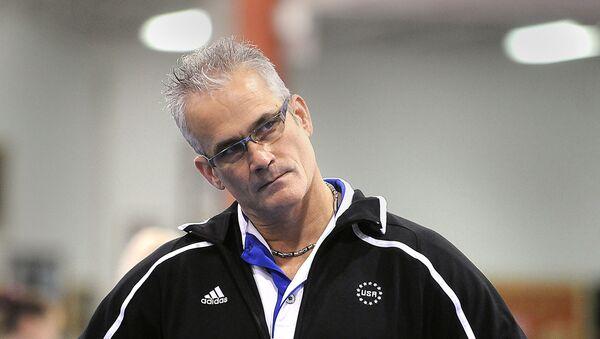 Gymnastics coach John Geddert watches his students during a practice in Lansing - Sputnik International