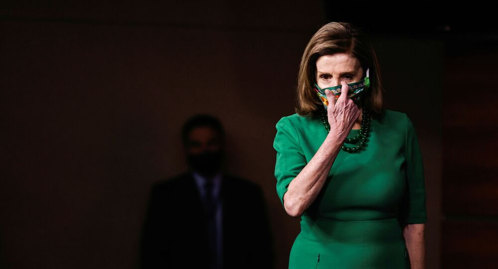 U.S. Speaker of the House Nancy Pelosi arrives for a news conference on the day the House of Representatives is expected to vote on legislation to provide $1.9 trillion in new coronavirus relief at the U.S. Capitol in Washington, U.S., February 26, 2021