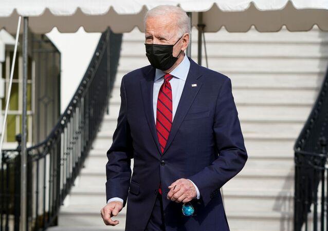 U.S. President Joe Biden stops to speak to the media as he departs for Wilmington, Delaware, from White House in Washington, U.S., February 27, 2021. REUTERS/Joshua Roberts