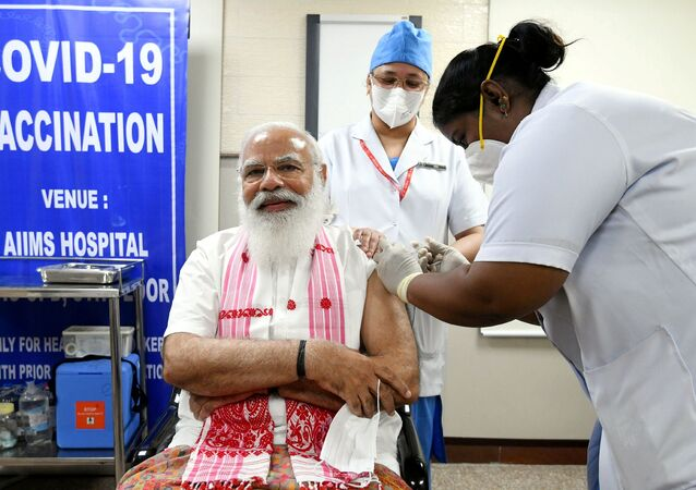 India's Prime Minister Narendra Modi receives a dose of COVAXIN, a coronavirus disease (COVID-19) vaccine developed by India's Bharat Biotech and the state-run Indian Council of Medical Research, at All India Institute of Medical Sciences (AIIMS) hospital in New Delhi, India, 1 March 2021