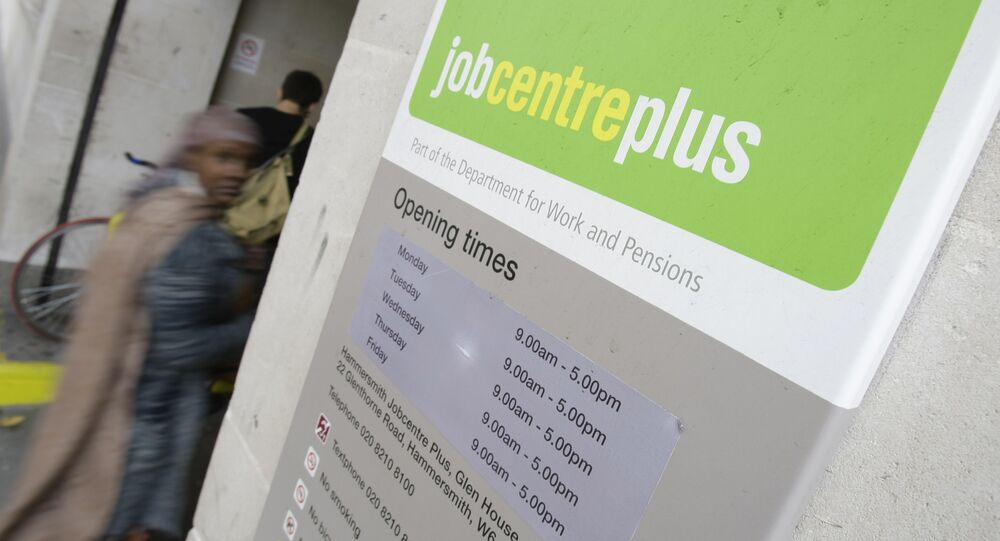 People enter a job centre in central London, Wednesday, Aug. 12, 2009