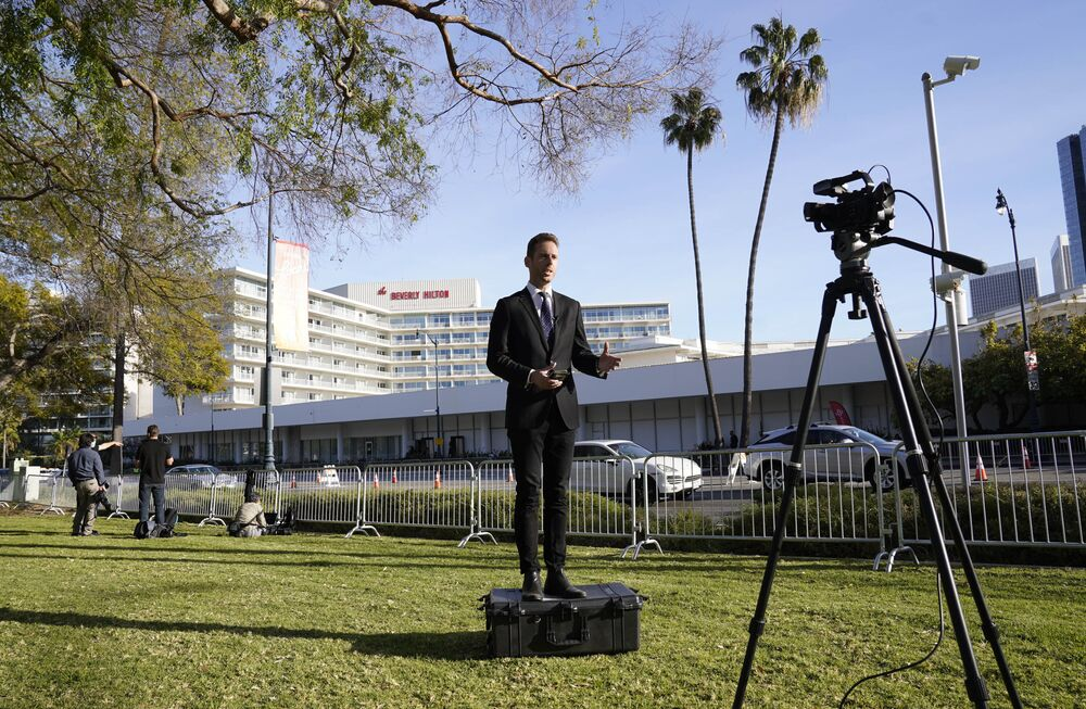 Duncan McKenzie-McHarg of Celebro Media reports from outside the 78th Golden Globe Awards at the Beverly Hilton, Sunday, 28 February 2021, in Beverly Hills, California.