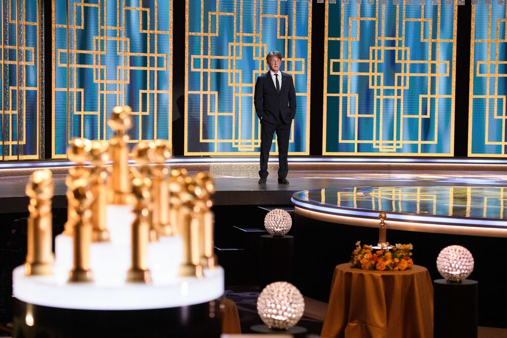 Sean Penn presents an award during the 78th Annual Golden Globe Awards in Beverly Hills, California on 28 February 2021. Usually a star-packed, laid-back party that draws Tinseltown's biggest names to a Beverly Hills hotel ballroom, this pandemic edition was broadcast from two scaled-down venues, with frontline and essential workers among the few in attendance.