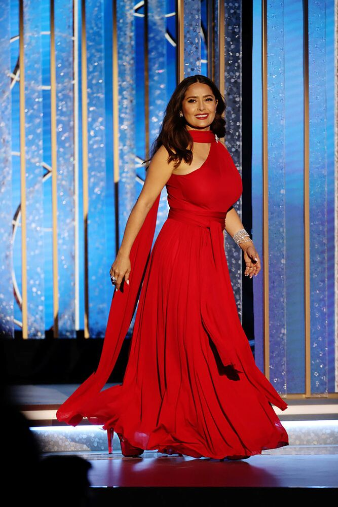 Actress Salma Hayek walks on stage in this handout photo from the 78th Annual Golden Globe Awards in Beverly Hills, California, 28 February  2021.