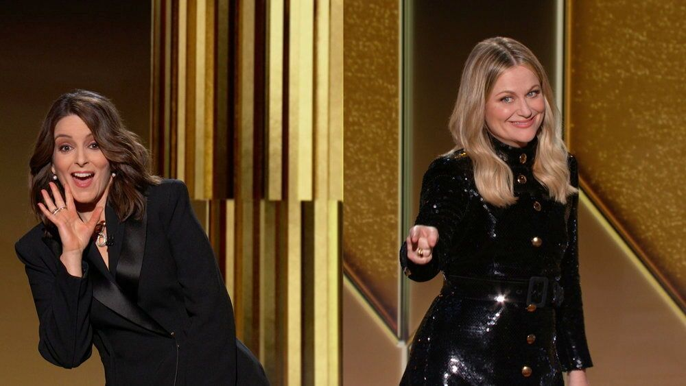 Hosts Tina Fey (L) and Amy Poehler (R) are seen in this handout screen grab from the 78th Annual Golden Globe Awards, in Beverly Hills, California, 28 February 2021.