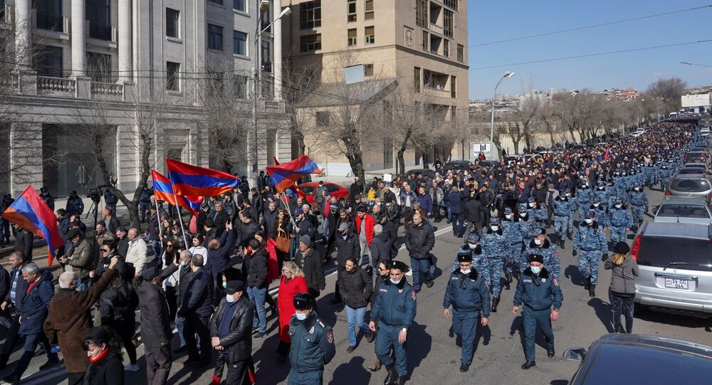 People attend an opposition demonstration to demand the resignation of Armenian Prime Minister Nikol Pashinyan in Yerevan, Armenia February 26, 2021