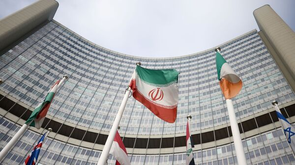 The Iranian flag waves in front of the International Atomic Energy Agency (IAEA) headquarters, amid the coronavirus disease (COVID-19) outbreak in Vienna, Austria, March 1, 2021. REUTERS/Lisi Niesner - Sputnik International