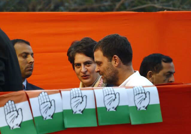 Congress party leader Rahul Gandhi, center, talks to his sister and party General Secretary Priyanka Vadra, as they arrive for an election campaign rally for the upcoming Delhi elections, in New Delhi, India, Tuesday, Feb. 4, 2020