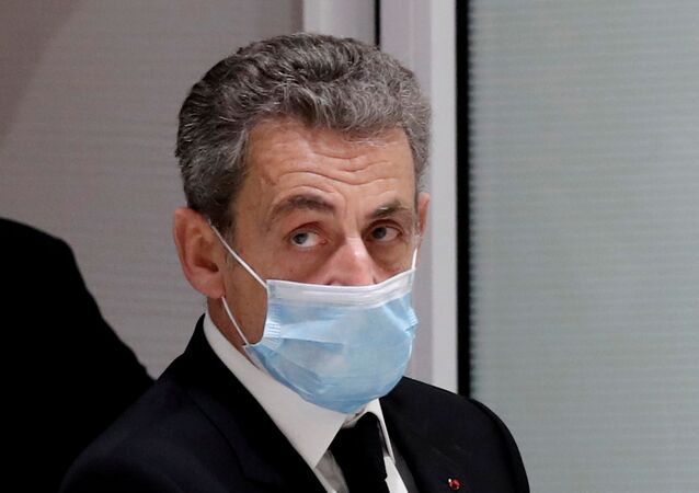 Former French President Nicolas Sarkozy leaves the courtroom during his trial on charges of corruption and influence peddling, at Paris courthouse, France, December 7, 2020. REUTERS/Benoit Tessier/File Photo