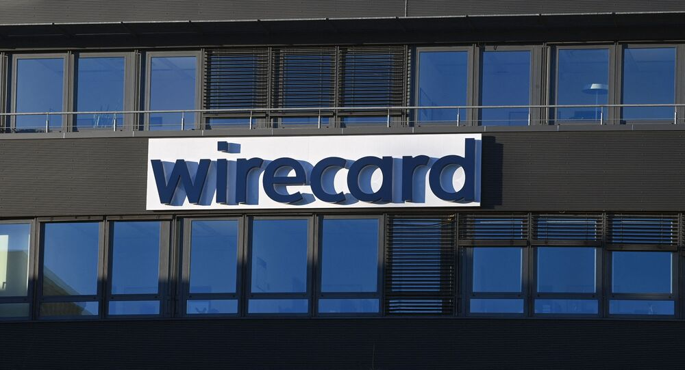 The logo of German payments provider Wirecard is seen at a building of the company's headquarters in Aschheim near Munich, southern Germany, on November 18, 2020 as the first creditors' event after the financial scandal takes place in Munich.