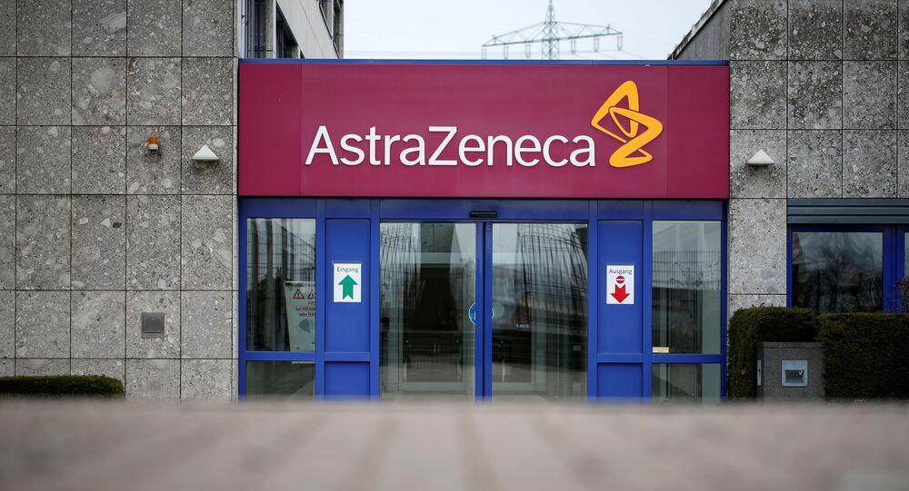 The logo of the German branch of British-Swedish pharmaceutical company AstraZeneca is pictured in Wedel near Hamburg, Germany, 1 March 2021.  REUTERS/Cathrin Mueller