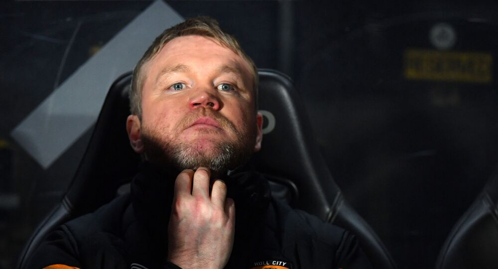 Hull City's Northern Irish head coach Grant McCann looks on ahead of the English FA Cup fourth round football match between Hull City and Chelsea at the KCOM Stadium in Kingston upon Hull, north east England on January 25, 2020.