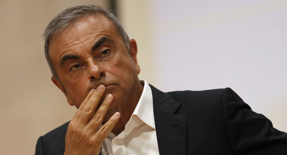 Former Nissan Motor Co. Chairman Carlos Ghosn holds a press conference at the Maronite Christian Holy Spirit University of Kaslik, as he launches an initiative to help Lebanon that is undergoing a severe economic and financial crisis, in Kaslik, north of Beirut, Lebanon, Tuesday, Sept. 29, 2020. Ghosn was arrested in Japan in 2018, and was awaiting trial on charges of under-reporting future income and breach of trust when he jumped bail and escaped to Lebanon late last year.