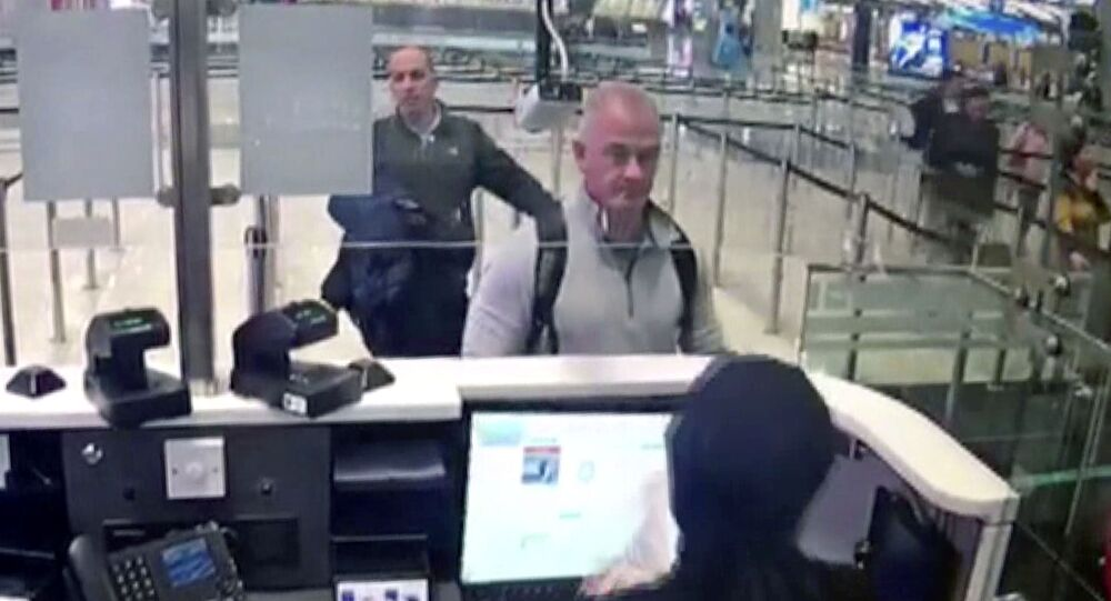 This Dec. 30, 2019 image from security camera video shows Michael L. Taylor, center, and George-Antoine Zayek at passport control at Istanbul Airport in Turkey. The U.S. State Department has agreed to turn over to Japan Taylor and his son Peter Taylor, who are accused of smuggling former Nissan Motor Co. Chairman Carlos Ghosn out of the country while he was awaiting trial, the men's lawyers said in legal filing on Thursday, Oct. 29, 2020