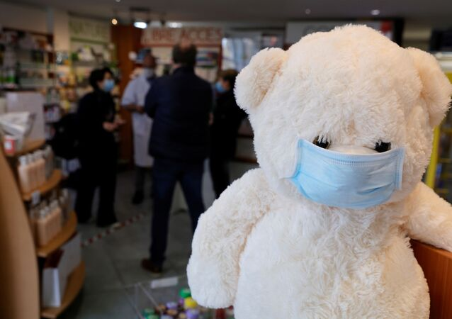 A teddy bear, wearing a protective face mask, is seen in a pharmacy in Gouzeaucourt amid the coronavirus disease (COVID-19) outbreak in France, February 25, 2021.