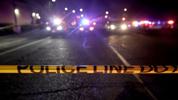 A police tape blocks a road near the scene where a Sacramento County Sheriff's deputy was shot and a suspect was shot and killed in the Sacramento suburb of Carmichael, Calif., 15 January 2021. - Sputnik International