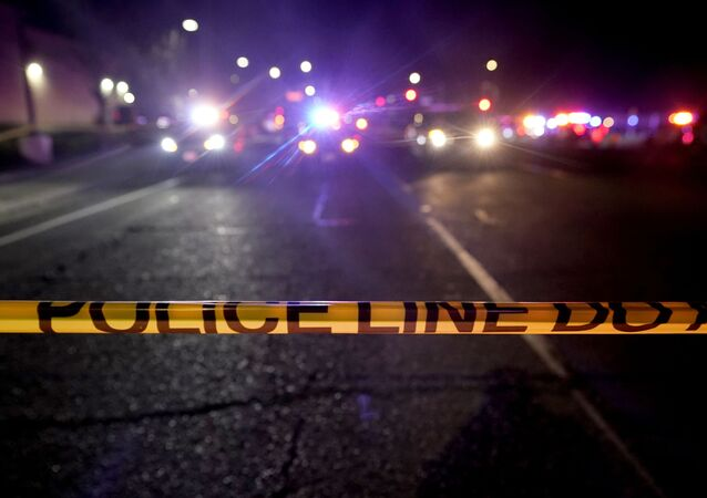 A police tape blocks a road near the scene where a Sacramento County Sheriff's deputy was shot and a suspect was shot and killed in the Sacramento suburb of Carmichael, Calif., Friday, Jan. 15, 2021.