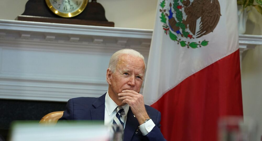 US President Joe Biden listens in to a virtual bilateral meeting with Mexican President Andres Manuel Lopez Obrador from the White House in Washington, DC, US, 1 March 2021.