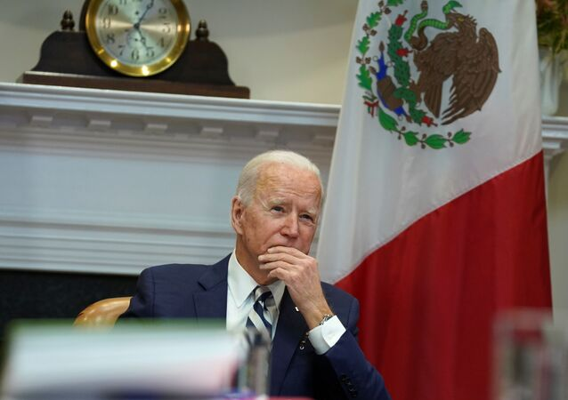 U.S. President Joe Biden listens during a virtual bilateral meeting with Mexican President Andres Manuel Lopez Obrador from the White House in Washington, U.S., March 1, 2021.
