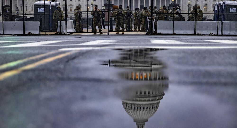 National Guard troops continue to guard the grounds of the US Capitol building in the extended security perimeter around Capitol Hill following the January 6th attack by a pro-Trump mob on February 11, 2021 in Washington, DC.