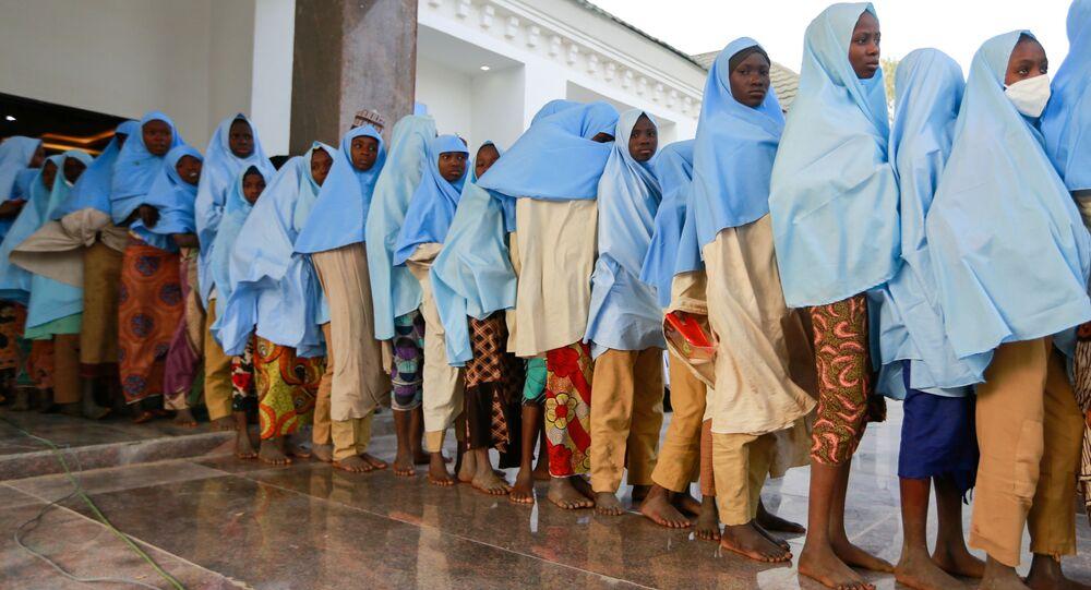 Girls who were kidnapped from a boarding school in the northwest Nigerian state of Zamfara, walk in line after their release in Zamfara, Nigeria March 2, 2021