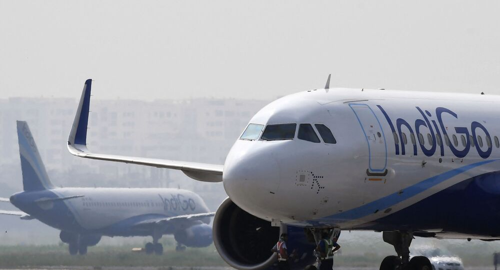 IndiGo aircraft are pictured on the tarmac at Netaji Subhas Chandra Bose International Airport in Kolkata on October 17, 2019.
