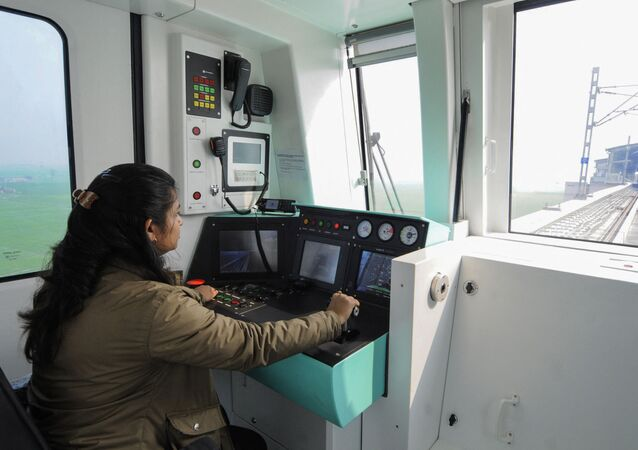 In this photo taken on January 13, 2019, an Indian woman worker controls a monitor in a metro train on the new Noida Metro Railway Network ahead of its opening in Noida, near the Indian capital New Delhi