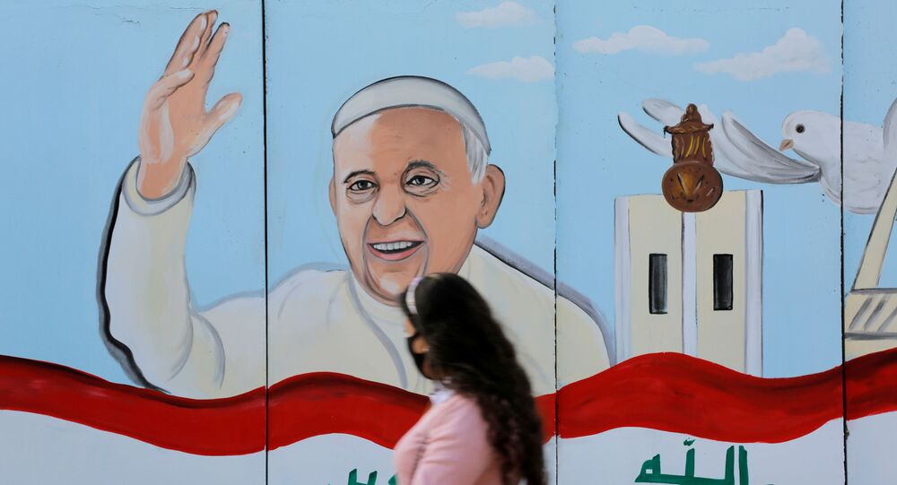 A mural of Pope Franci is seen on the wall of a church upon his upcoming visit to Iraq, in Baghdad.
