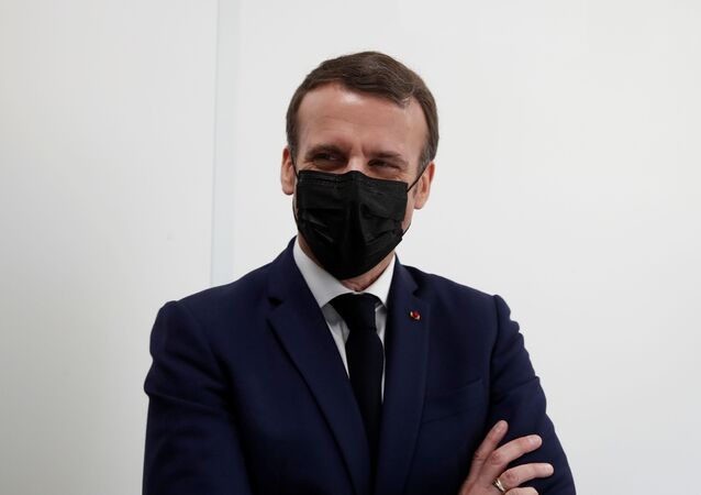 French President Emmanuel Macron, wearing a protective face mask, visits a coronavirus disease (COVID-19) vaccination center at the Caisse Primaire d'Assurance Maladie (France's local health insurance funds - CPAM) in Bobigny near Paris as part of the COVID-19 vaccination campaign in France, March 1, 2021.