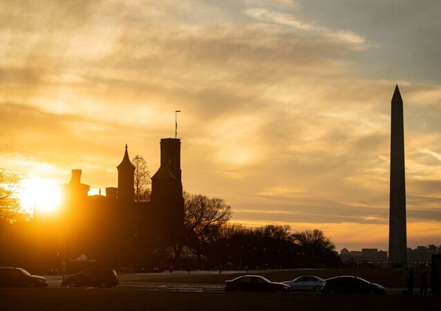 The Washington Monument and the Smithsonian Castle, as the sun sets in Washington, U.S., February 21, 2021.