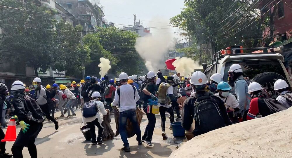 Protesters set off smoke grenades to block the view from snipers in Sanchaung, Yangon, Myanmar March 3, 2021