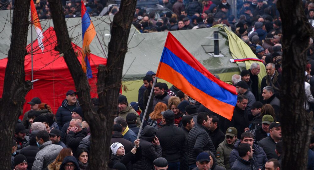 Opposition supporters rally outside the National Assembly building to demand Prime Minister Nikol Pashinyan's resignation on 1 March 2021.