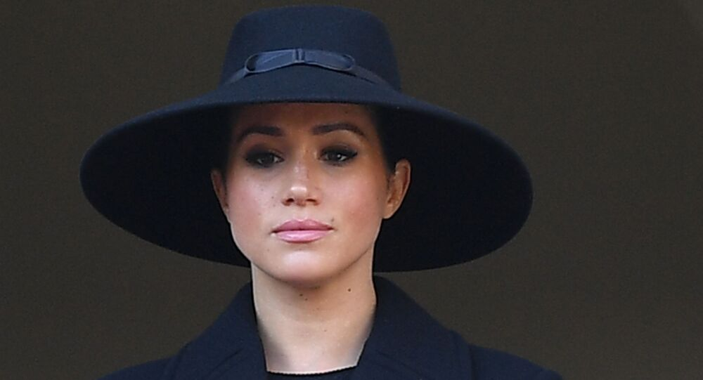 Britain's Meghan, Duchess of Sussex looks on from a balcony as she attends the Remembrance Sunday ceremony at the Cenotaph on Whitehall in central London, on November 10, 2019.