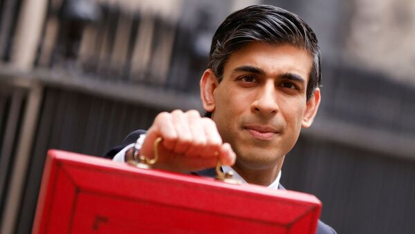 Britain's Chancellor of the Exchequer Rishi Sunak holds the budget box outside Downing Street in London, Britain, March 3, 2021.  - Sputnik International