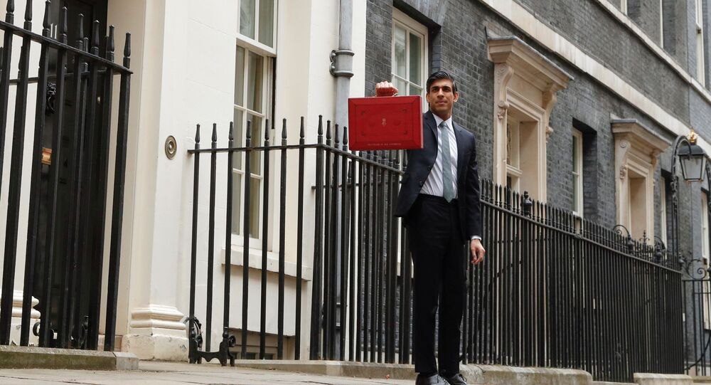 Britain's Chancellor of the Exchequer Rishi Sunak holds the budget box outside Downing Street in London, Britain, March 3, 2021