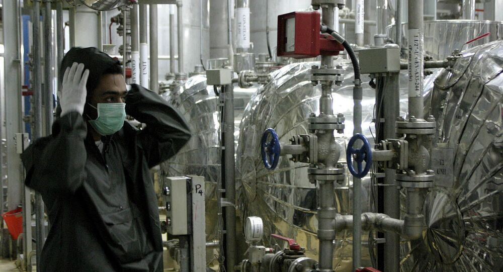 An Iranian worker adjusts his hat at  Iran's Isfahan nuclear, UCF, facility on Saturday, Nov. 20, 2004