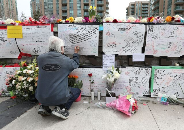 In this file photo Jack Young leaves a note on April 24, 2018, at a makeshift memorial for victims in the van attack in Toronto, Ontario.