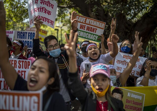 Chin refugees from Myanmar shout slogans during a protest against military coup in Myanmar, in New Delhi, India, Wednesday, March 3, 2021