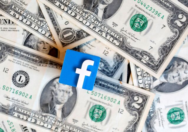 A 3-D printed Facebook logo is seen on U.S. dollar banknotes in this illustration picture, June 18, 2019.