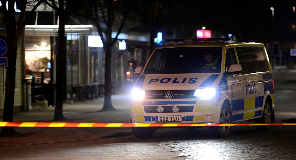 Police work at a knife attack site in Vetlanda, Sweden March 3, 2021.