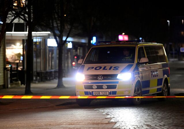Police work at a knife attack site in Vetlanda, Sweden March 3, 2021.