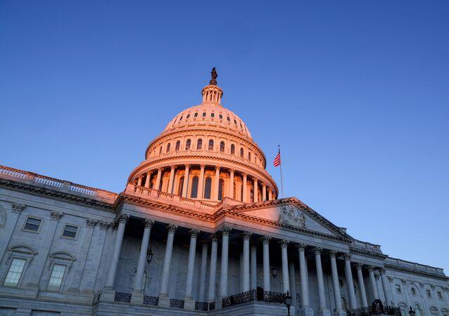 The sun rises on the U.S. Capitol dome before Joe Biden's presidential inauguration in Washington, U.S., January 20, 2021.