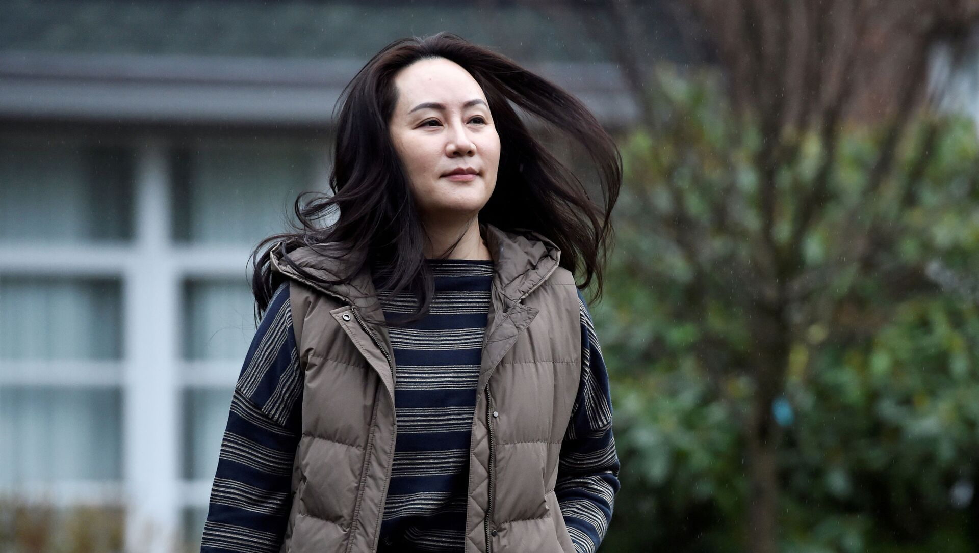Huawei Technologies Chief Financial Officer Meng Wanzhou leaves her home to attend a court hearing in Vancouver, British Columbia, Canada December 7, 2020. - Sputnik International, 1920, 14.06.2021