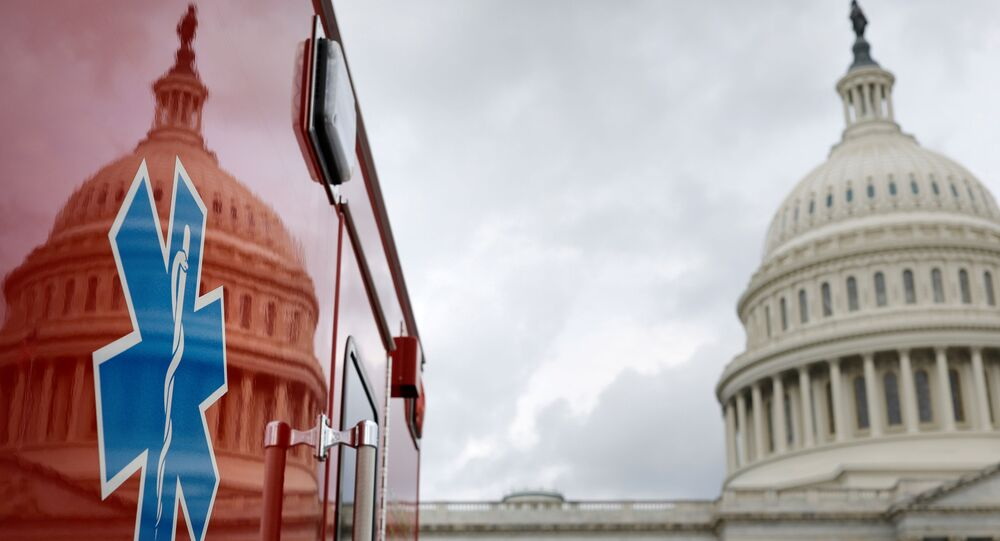 The U.S. Capitol Building is reflected against an ambulance along the East Front on Capitol Hill in Washington, U.S., July 16, 2020