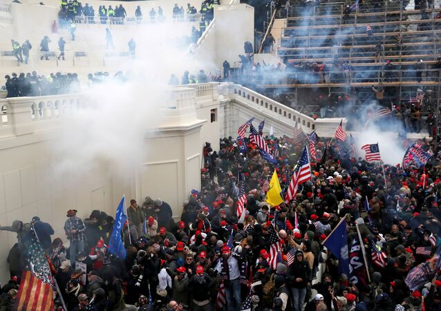 A mob of supporters of former U.S. President Donald Trump fight with members of law enforcement at a door they broke open as they storm the U.S. Capitol Building in Washington, U.S., January 6, 2021